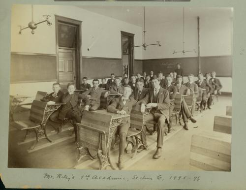 A classroom of students sitting at desks at St. Ignatius College and looking at the camera.