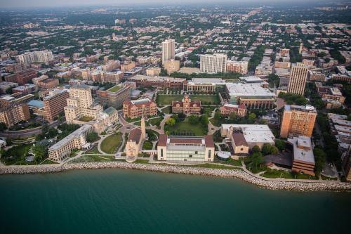 A ariel shot of Loyola's Lake Shore Campus with Lake Michigan bording the bottom.