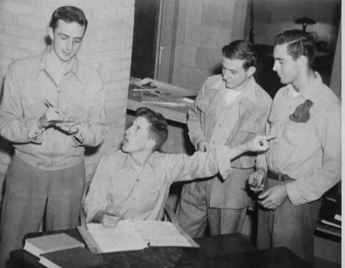 Loyola Students at a newsroom meeting